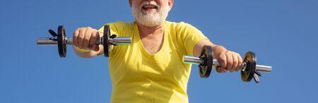 Elderly man after her workout. Senior man in health club. Senior man workout in rehabilitation center. Reklamní fotografie - 128605048