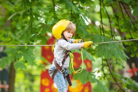 Small boy enjoy childhood years. Helmet and safety equipment.