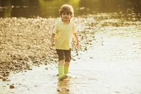 Kids lifestyle concept. Cute child having fun on River. Stock Photo