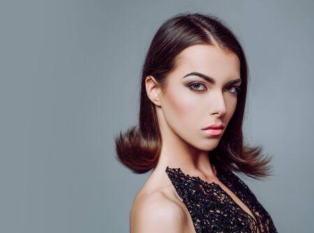 Beauty woman face. Makeup, smooth skin. Advertisement, magazine. Art design, make up. Close-up portrait. Hairstyle styling. Fashion, beauty, cosmetics.