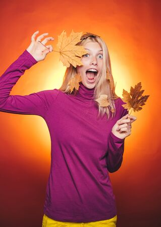 Woman happy autumn in autumn park. Autumn discounts on lingerie. Sale of womens panties. Leaf fall. Happy young woman having fun with Leaf fall. Fashion portrait of beautiful sensual woman.