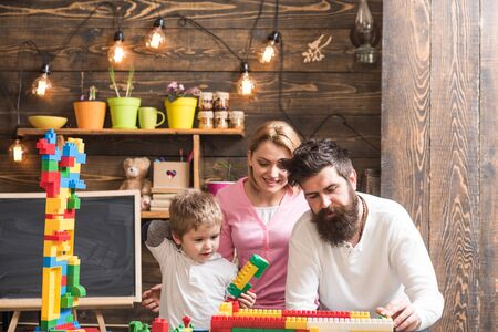 Kindergarten concept. Little boy play with toy bricks in kindergarten. Family building structure model in kindergarten. Kindergarten and nursery Reklamní fotografie