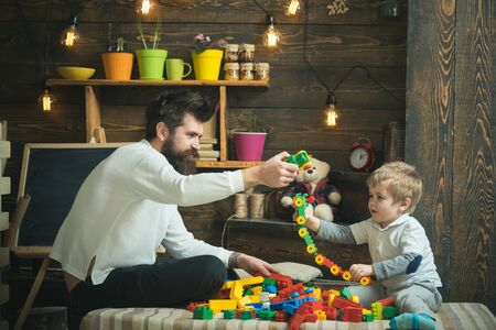 Fathers day concept. Father and baby son play with toys on fathers day. I have fathers day everyday. Happy fathers day. My dad is my best mate