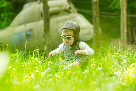 Child and blurred helicopter on natural background