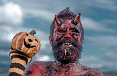 Halloween dragon smiling with jack o lantern