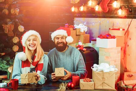 Christmas couple. winter freands wearing red santa claus hat. Sensual couple for Christmas. Winter holidays and people concept. 版權商用圖片