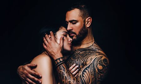 Man hugging woman with love. Sensual couple in love. Erotic love of hispanic man and sexy woman Фото со стока