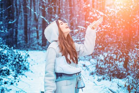 Winter girl having fun in winter park. Global cooling. Winter portrait of young woman in the winter snowy scenery. Banco de Imagens