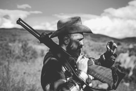 Hunting. Hunter with shotgun gun on hunt. Hunter in the fall hunting season. Texas ranger. Stockfoto