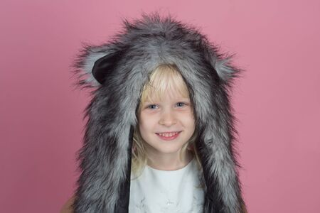 Keeping your little ones happy and warm in winter. Little fashionista. Little girl wear winter hat scarf. Happy child smile in fashion style. Winter fashion trends for kids. A snuggly feel