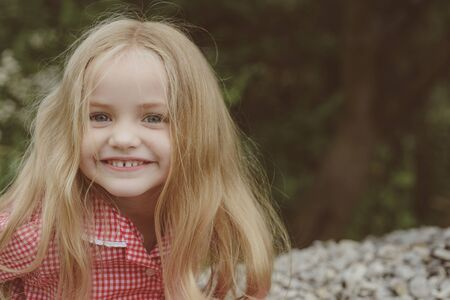 Cherish all your happy moments. Little child wear long hair. Small girl with blond hair. Happy little child with adorable smile. Small girl happy smiling. A full head of hair