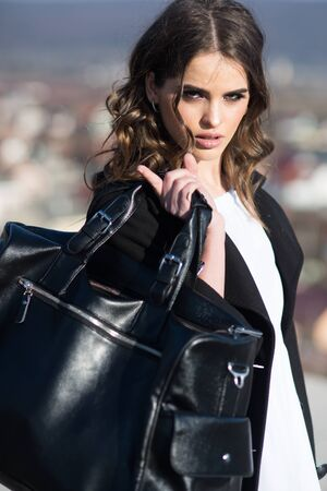 Beauty and fashion look. Fashion woman with stylish makeup and curly hair. autumn fashion of business woman with bag. Pretty girl with fashionable hair. Pure beauty. Feeling flirty