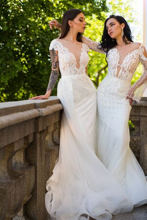 Elegant wedding salon is waiting for bride. Beautiful wedding dresses in boutique. Engagement. Happy bride before wedding. Wonderful bridal gown. women is preparing for wedding. Welcome to family Stock Photo