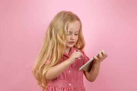 I like retro stuff. Little shopaholic shopping online. Little girl shopping on smartphone. Small girl in e shop. Small shopper use mobile phone for e-shopping. Online shopping makes everything easier