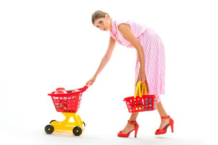 Looking good. retro woman hurrying to buy products. Great day for shopping. Just one moment. shopping sale advertisement for to attract customers. fashionable retro woman customer ready to pay.