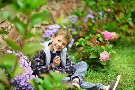 In love with spring. Happy boy enjoy spring blossom. Little boy relax in spring garden. No spring skips its turn