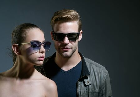 Beautifully crafted sunglasses. Friendship relations. Fashion models in trendy glasses. Couple in love. Couple of man and woman wear fashion glasses. Love relations. Friendship day. Young expertise Zdjęcie Seryjne