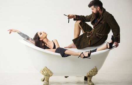 Shaving concept. Bearded man with shaving razor and woman relax in bath. Shaving salon. Shaving everyday grow beard Zdjęcie Seryjne