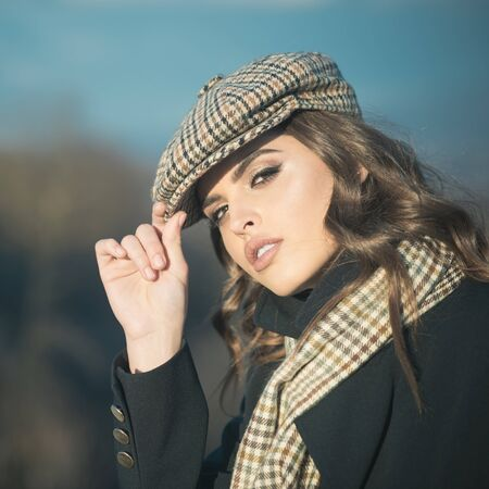 french girl with curly hair in autumn beret. Beauty and fashion look. Confident in her choice. vintage woman with makeup. retro fashion woman with makeup, parisian. Looking trendy