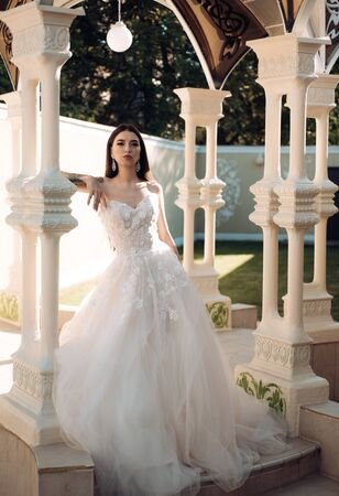 woman is preparing for wedding. Happy bride before wedding. Wonderful bridal gown. Beautiful wedding dresses in boutique. Elegant wedding salon is waiting for bride. Extremely happy. Bride to be