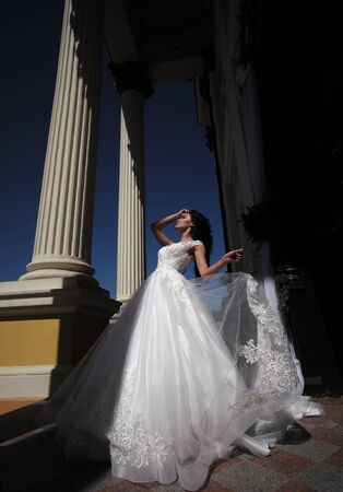Elegant wedding salon is waiting for bride. Happy bride before wedding. Wonderful bridal gown. Beautiful wedding dresses in boutique. woman is preparing for wedding. Extremely happy. Bride to be