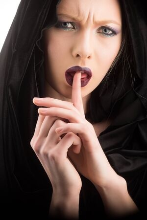 Beautiful woman with a black cloth. dark lips of girl under hood 写真素材 - 128879659