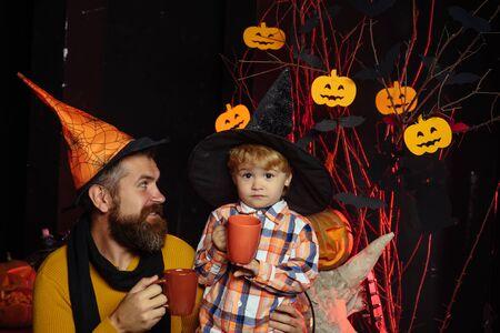 halloween man with child in witch hat drink milk Zdjęcie Seryjne
