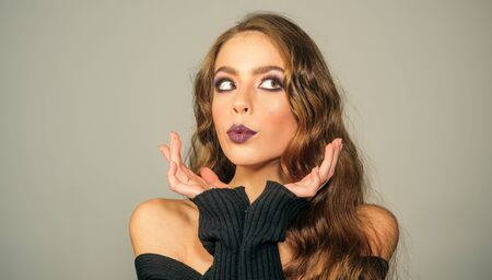 Makeup cosmetics and skincare. fashion girl with glamour makeup. Fashion portrait of woman. Beauty salon and hairdresser. woman with fashion makeup and long curly hair. Confident and stylish beauty