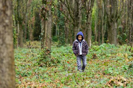 Homeless and abandoned. Homeless child walk in woods. Homeless boy without parental care outdoor. Street child has to seek homeless shelter and food. Homelessness among children is a serious issue
