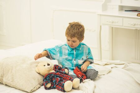 child play toys. little boy play at home. Little boy playing with bear. happy family and childrens day. happy childhood. Care and development. Amazing day. On style. Involved in joy