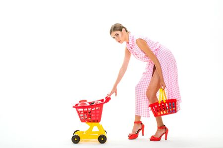Checking shopping list. vintage woman go shopping in mall with products. Making the retail connection. vintage woman go shopping with cart isolated on white, copy space. playing shopaholic.