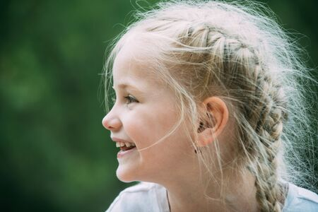 Enjoying new hair look. Little girl wear hair in long plaits. Happy little child with adorable smile. Small child happy smiling. Small girl with blond hair. Carefree and happy 版權商用圖片