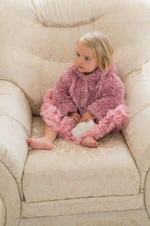Because its your hair. Little child wear natural hairstyle. Adorable child with blond hair relax in armchair. Little girl with long hairstyle. Hair salon for kids. Share a new perfection