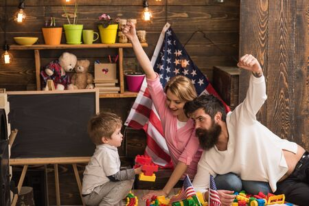 Family reunion. Family reunion for independence day. Family reunion with american flags in preschool. National holiday celebration with family reunion. United we stand