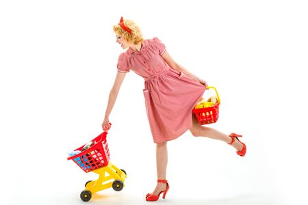 Joyful woman enjoying online shopping. happy retro woman go shopping. It is perfect. Next stop is shop. What to buy. retro woman advertising shopping with full cart. cyber monday concept 写真素材
