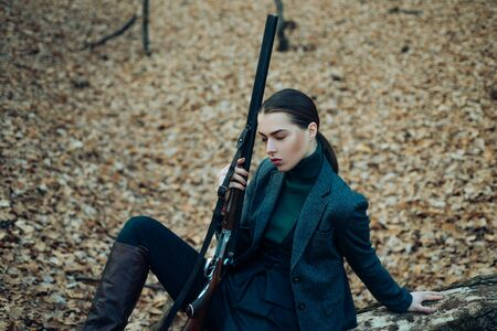 military fashion. achievements of goals. female hunter in forest. successful hunt. hunting sport. girl with rifle. chase hunting. Gun shop. woman with weapon. Target shot. hunt in an autumn forest