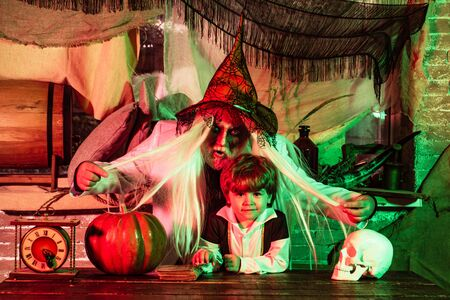 Father and son play Halloween. Scary stories. Happy family celebrate Halloween. Portrait of funny family during Halloween