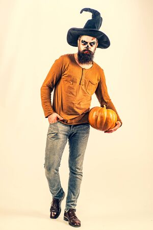 Scary face. Fantasy horror Halloween. Halloween 31 October. Scary hipster with beard in Halloween hat. Happy Halloween. Funny character comic Dracula.