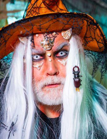 Halloween insect, bug - portrait close up. Bearded man dressed like Halloween monster. Halloween bearded man with blood make-up. Bearded man dressed like Halloween monster Фото со стока