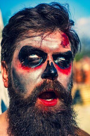 Bearded man dressed like Halloween monster - close up. Horror with scary Halloween man. Halloween man with blood make-up. Celebrate Halloween in America. Stockfoto