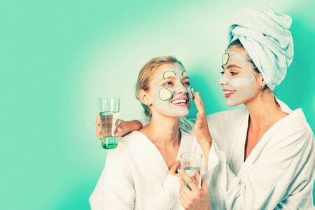Stay beautiful. Skin care for all ages. Women having fun cucumber skin mask. Relax concept. Beauty begins from inside. Spa and wellness. Girls friends sisters making clay facial mask