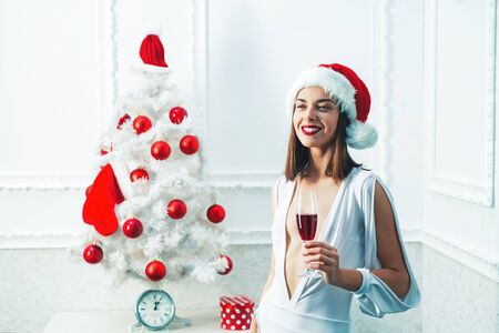Christmas woman with red wine. Champagne new year party. Merry xmas and happy new year. Christmas girl concept.