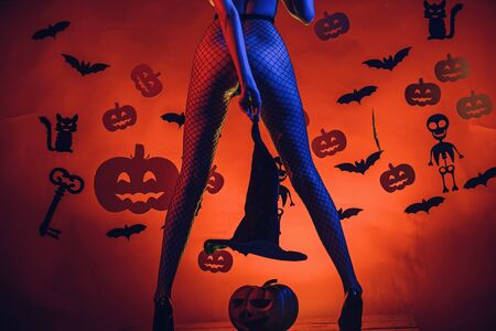 Halloween Womens clothing store celebrates. Sexy Horror background. Halloween sexy concept. Female with sexy ass posing. Sexy Model Posing In Lingerie on halloween background. Фото со стока - 129321950
