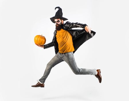 Portrait of funny man with Halloween skull make up showing his emotions - full length. Design for Halloween banner. Vampire man on Halloween night. Halloween concept. Фото со стока