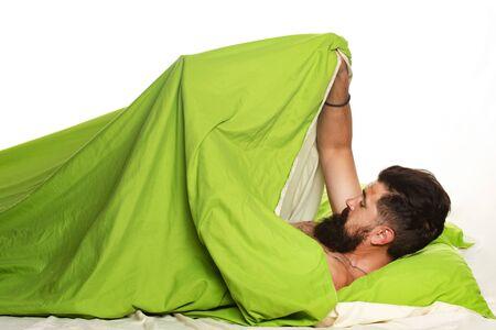Sexual potency. Imitating erection. Joyful man sleeping on a bed. Wake up Sleepy.