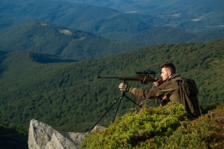 Autumn hunting season. Hunter Target with laser sight. Man hunter with a gun. Wildlife Hunting. Mountain hunting. Stock Photo