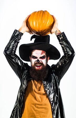 Happy Halloween - handsome vampire isolated on dark background. Design for Halloween banner. Scary face. Halloween 31 October.