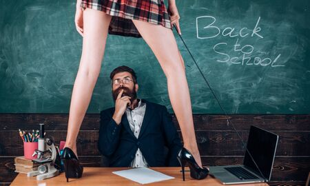 Curious sexy learner. Sex role game. Man bearded teacher and female mini skirt sexy legs. Erotic lesson concept. Subordinate and submission. Desirable sexy student. Sex education for all ages