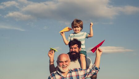 Men generation. Father and son with grandfather - happy loving family. Enjoy family together. Grandfather with son and grandson having fun in park. Stock Photo