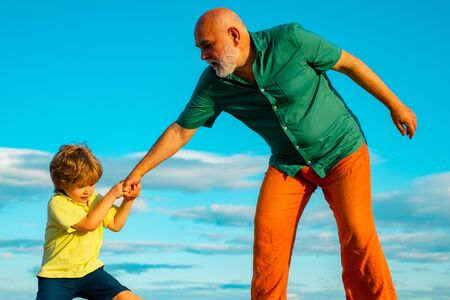 Father helping hand extended. We must educate our youngsters better. Grown up rebuking a little child for bad behavior.